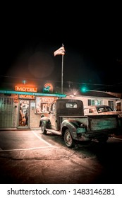 Barstow, California / United States »; August 2019: Route 66 Motel, the beautiful motel and its reception at night, vertical photo