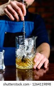 bartender at the bar stir cocktail