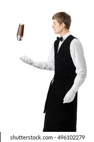 Bartender juggling with shaker and making cocktail isolated on white background