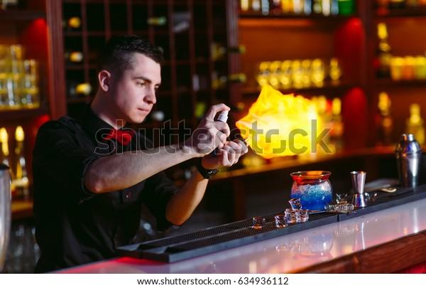 Bartender makes hot cocktail.