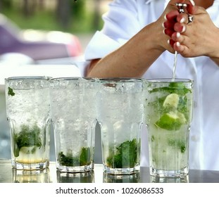 bartender makes mojito