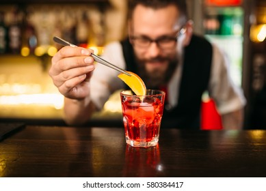 Bartender making alcohol coctail in restaurant
