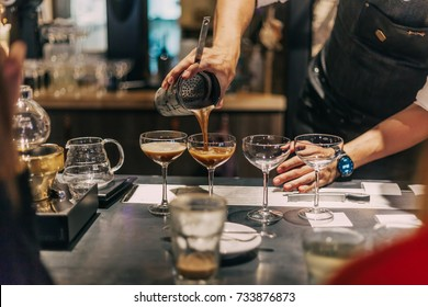 Bartender making alcoholic cocktail at the bar