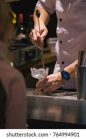 Bartender making alcoholic cocktail in coffee shop