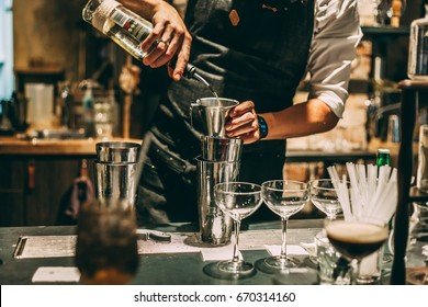Bartender making alcoholic cocktail, summer cocktail in bar.