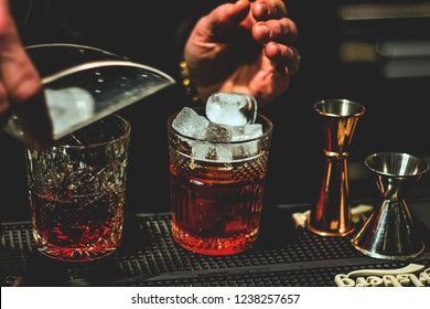 Bartender making Negroni cocktail