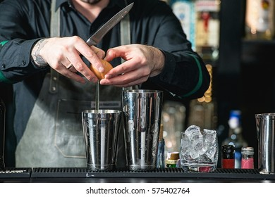 bartender making relaxing coctail on a bar background