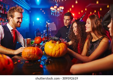 Bartender meeting guests at Halloween night