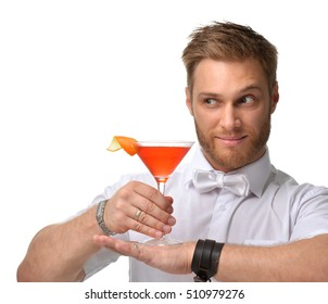 Bartender men is making red margarita martini cocktail with orange happy smiling and looking at the corner isolated on a white background