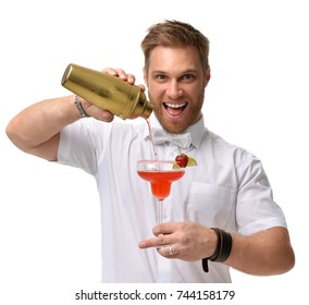 Bartender men is preparing red margarita cocktail with strawberry and lime. Hold big glass and pours alcohol from a gold shaker isolated on a white background