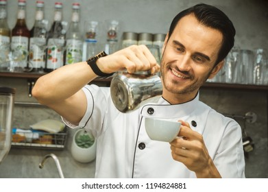 Bartender pour milk to coffee cup
