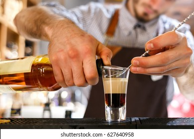 bartender prepares B52 Shot