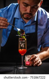 Bartender preparing fancy champagne cocktai
