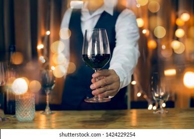 Bartender Serve  wine, on wood bar,