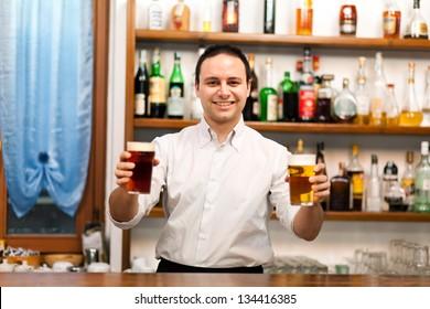 Bartender serving beer