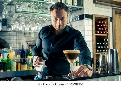 Bartender serving espresso martini layered cocktail coffee vodka bar shaker