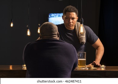 Bartender talking with a customer
