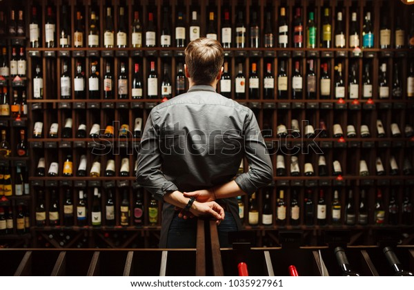 Le Bistrot - Page 5 Bartender-wine-cellar-full-bottles-600w-1035927961