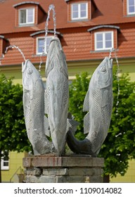 Barth, Germany, May 27, 2018: Fountain with three fishes