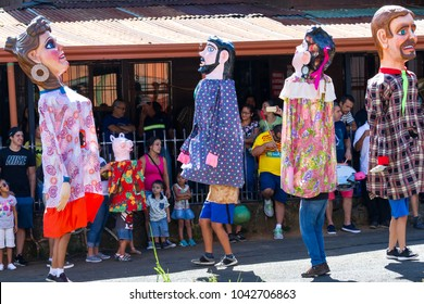 Barva, Costa Rica - January 27: Typical masquerade with families watching the show in the shade. January 27 2018, Barva, Costa Rica