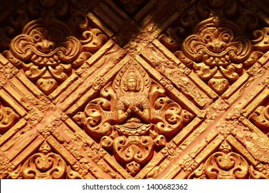 Bas relief carvings of an apsara (fairy) and kala (mythical monster) in the walls of Wat Khmer Munireangsey in Can tho Vietnam that is free and open to everyone