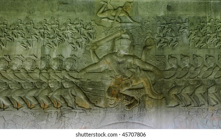 Bas relief 'Churning of the ocean of milk'. In Hinduism, Samudra manthan (Devanagari) or The churning of the ocean of milk is one of the most famous episodes. Angkor Wat. Cambodia