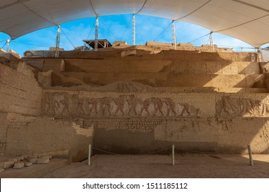 Bas relief decorations and adobe wall constructions of the Huaca Cao Viejo pyramid from the Moche civilization located in the desert between Chiclayo and Trujillo, Peru.