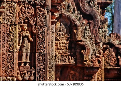 Bas relief of Devatas or Dvarapalas on facade and wall of Banteay Srei (Citadel of Women), Cambodian red sandstone temple praised as a Precious gem or Jewel of Khmer art, Angkor, Siem Reap, Cambodia
