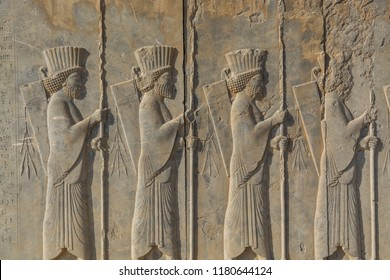 Bas relief on the wall of ruins in the Persepolis in Shiraz, Iran. The ceremonial capital of the Achaemenid Empire. UNESCO World Heritage