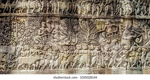 Bas relief sculpture, elephant charging into battle and the battle between the Cham and Khmer. The battles conducted by Jayavarman VII against the invading Cham. Bayon Temple, Angkor Thom, Seam Reap.