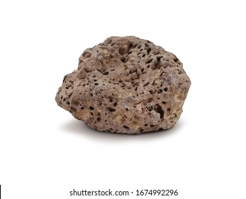 Basait stone isolated on white background. Basalt is a dark-colored, fine-grained, igneous rock composed mainly of plagioclase and pyroxene minerals. It most commonly forms as an extrusive rock,