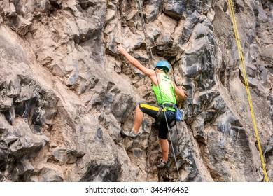 Basalt Challenge Of Tungurahua, Man Climbing Vertical Rock Wall