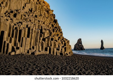 Basalt columns bask in the afternoon sun along the southern Icelandic coast.