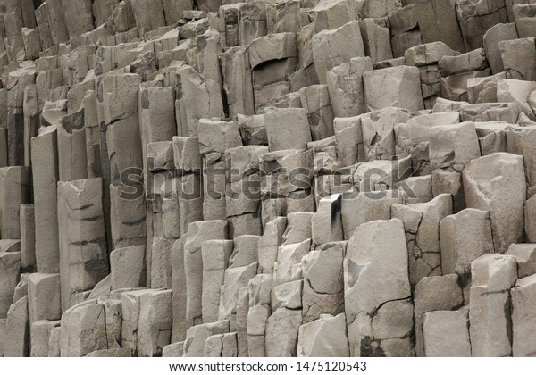 Basalt columns ( formation ) in Iceland on mountain Reynisfjall. Texture stone close-up