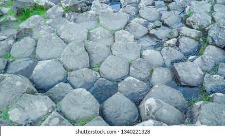Basalt columns of rocks in Giants Causeway these rocks colums are believed to be from the big volcanic eruption