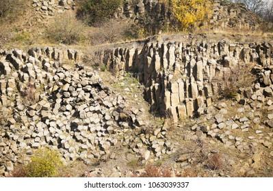 Basalt columns and stones - volcanic rocks