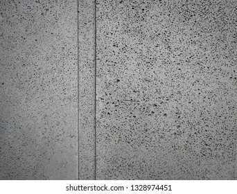 Basalt stone background .Basalt is a common extrusive igneous (volcanic) rock formed from the rapid cooling of basaltic lava exposed at or very near the surface of a planet or moon.