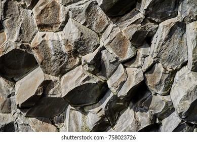 Basalt stone columns close-up on Reynisfjara black beach