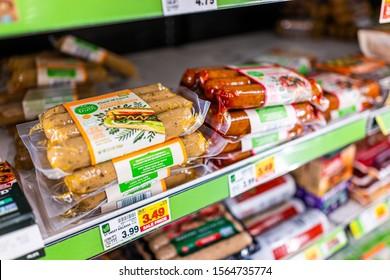 Basalt, USA - September 19, 2019: Supermarket grocery store shelf with sale price for vegan Simple Truth plant based sausages in City Market Kroger