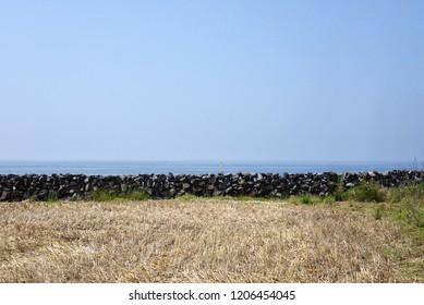 basalt wall in Jeju island, horizontal line, sea line in Jeju