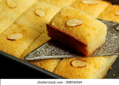 Basbousa (Namoora) -Egyptian semolina cake with almonds and rose syrup