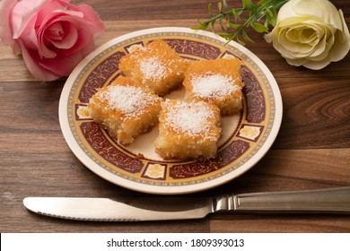 Basbousa or Namora cake with traditional Arabic semolina with wooden background