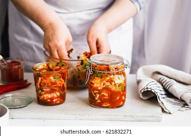 Base Cabbage Kimchi. Person preparing cabbage kimchi. Fermented and vegetarian  preserved food concept.