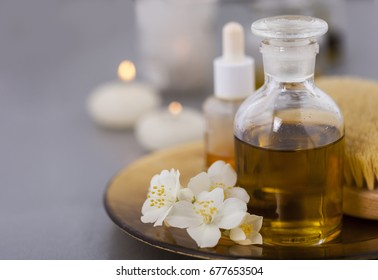 Base oil with essential oils and candles. The concept of Spa and relaxation