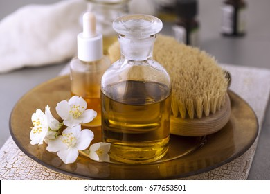 The base oil with essential oils and jasmine flower.