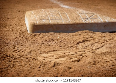 Base on the dirt infield of baseball field