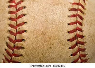 Baseball background with closeup of worn ball