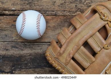 Baseball ball on wooden background.