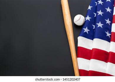 baseball and baseball bat with American flag on the black background