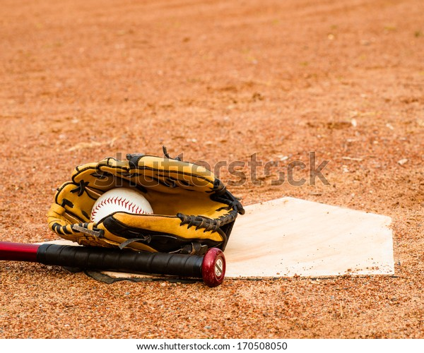 Baseball, Bat and glove close up near home plate with room for copy